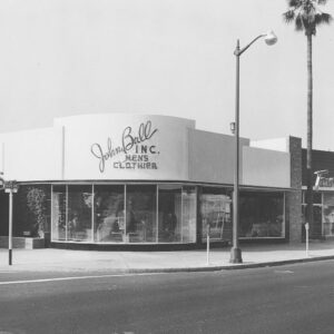 black and white store front on street corner